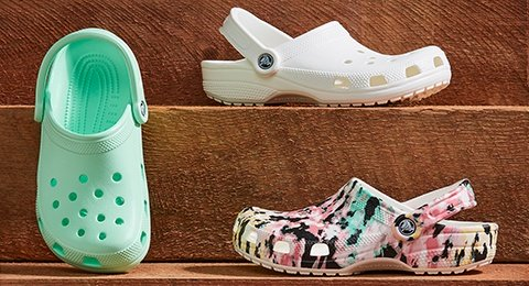 Classic Clogs in Neo Mint, Classic Clogs in White, and Classic Tie-Dye Mania Clogs in Multi/Light Grey.